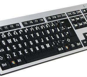 Tangentbord med stor vit text med svart bakgrund PC